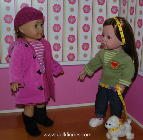 2 muñecas tiernas con un perrito