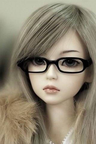 muñeca bonita con gafas