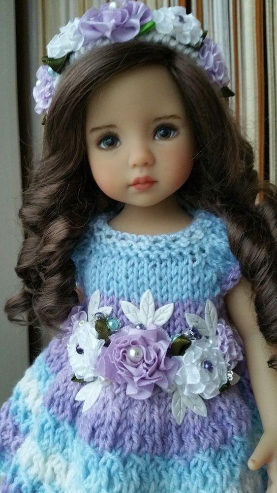 muñeca moños morados