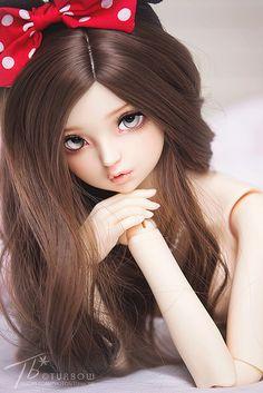 muñeca tierna con moño