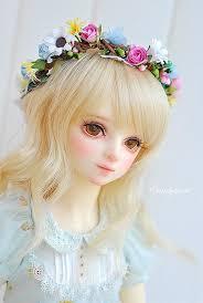 muñecas con flores